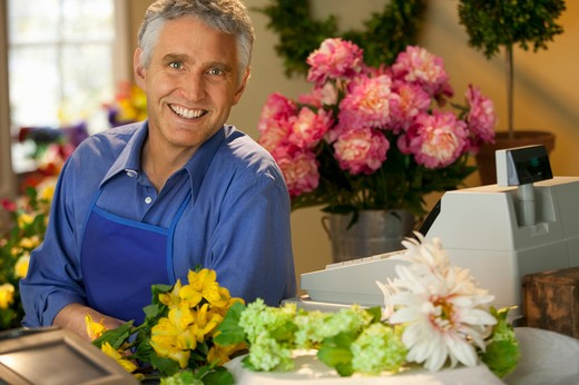 small business owner/florist in shop : Stock Photo