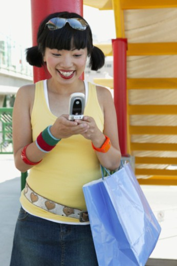 Woman text messaging on cell phone : Stock Photo