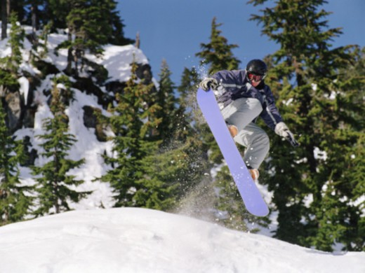 Stock Photo: 1555R-331378 Snowboarder jumping