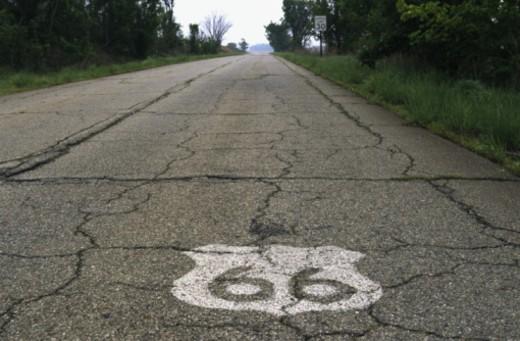Route 66 shield on Kansas road : Stock Photo