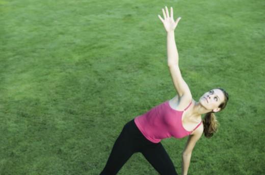 Woman in yoga pose : Stock Photo