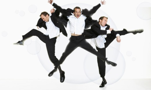 Stock Photo: 1555R-331509 Enthusiastic men kicking and jumping in formal wear
