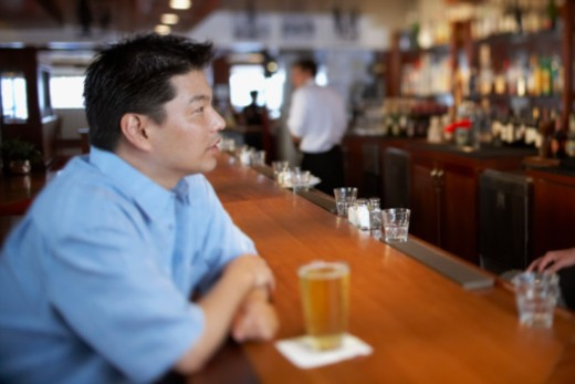 Man at bar : Stock Photo