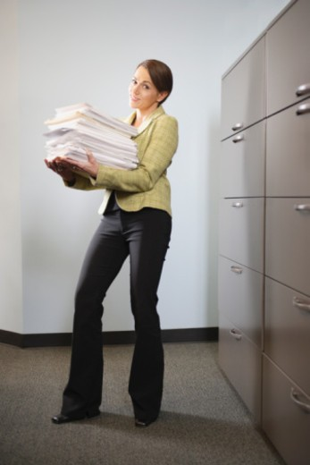 Woman carrying files : Stock Photo