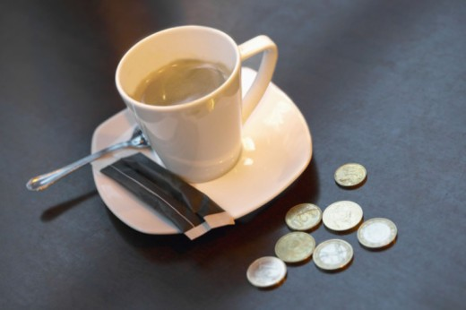 Stock Photo: 1555R-331657 Coffee and money on a table
