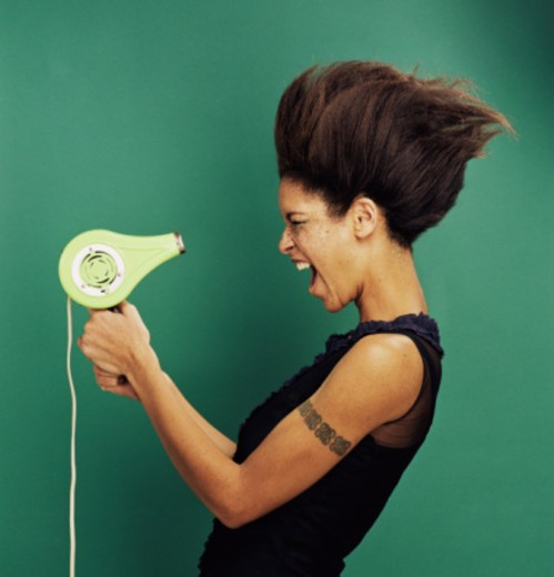 Woman with blow dryer : Stock Photo