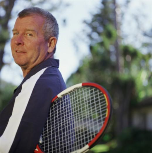 Man holding tennis racket : Stock Photo