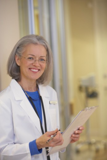 Stock Photo: 1555R-332631 Smiling doctor