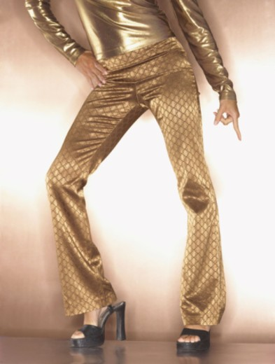 Hip woman in gold disco dancing : Stock Photo