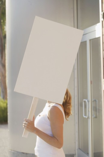 Stock Photo: 1555R-332704 Woman holding blank sign