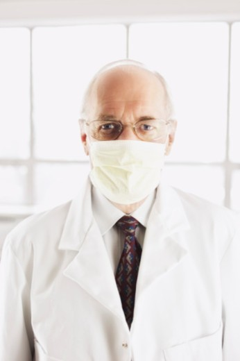 Stock Photo: 1555R-332786 Doctor wearing mask