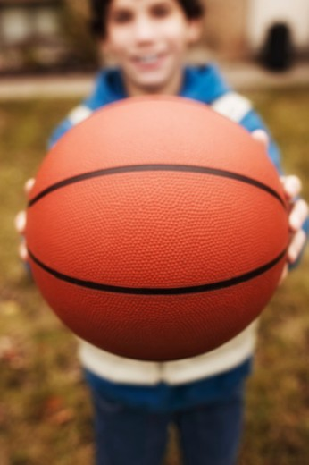 Boy with basketball : Stock Photo