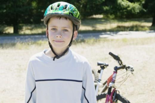 Boy wearing bike helmet : Stock Photo