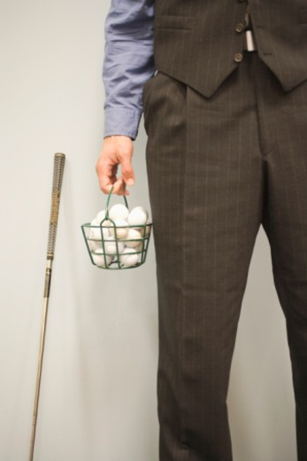 Businessman with golfing equipment : Stock Photo