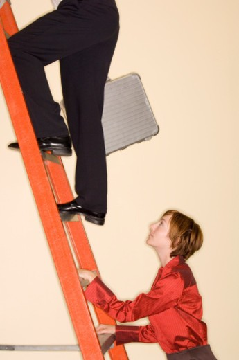 Stock Photo: 1555R-334136 Businesspeople climbing ladder