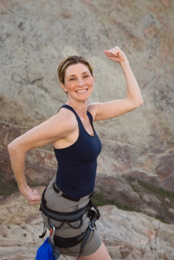 Stock Photo: 1555R-335201 Smiling woman flexing her biceps
