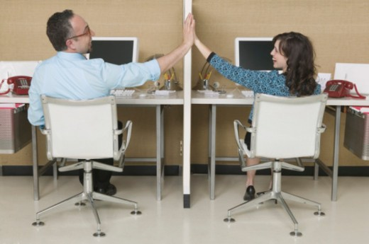 Colleagues giving each other a high-five : Stock Photo
