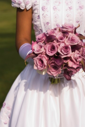 Stock Photo: 1555R-336139 Teenage girl with bouquet
