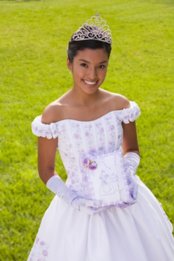 Teenage girl with bible at quinceanera : Stock Photo