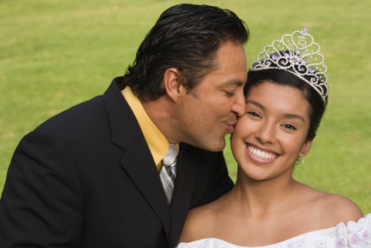 Stock Photo: 1555R-336146 Father kissing daughter at quinceanera