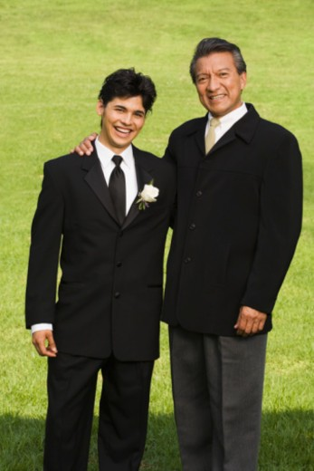 Stock Photo: 1555R-336150 Man and teenage boy at quinceanera