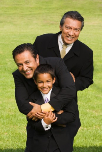 Stock Photo: 1555R-336152 Grandfather, father and son at quinceanera