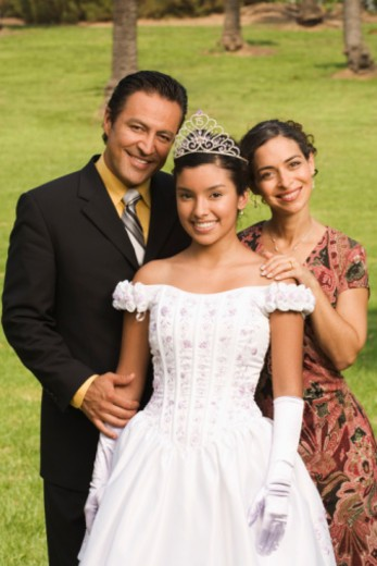 Stock Photo: 1555R-336156 Portrait of family at quinceanera