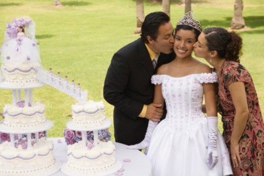Parents kissing daughter at quinceanera : Stock Photo
