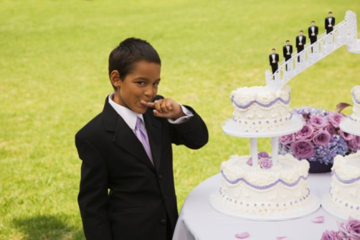 Stock Photo: 1555R-336162 Boy eating cake at quinceanera