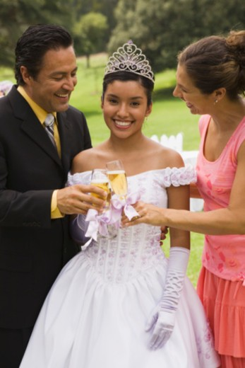 Family toasting at quinceanera : Stock Photo