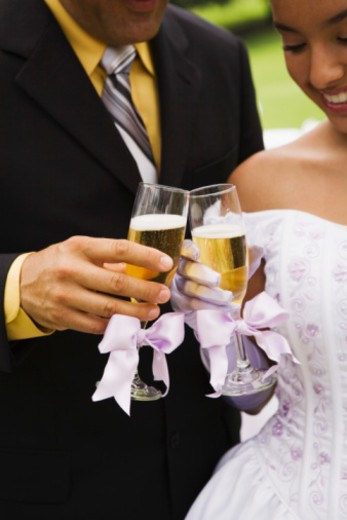 Stock Photo: 1555R-336164 Father and daughter toasting at quinceanera