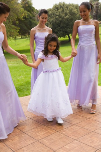 Quinceanera court on dancefloor : Stock Photo