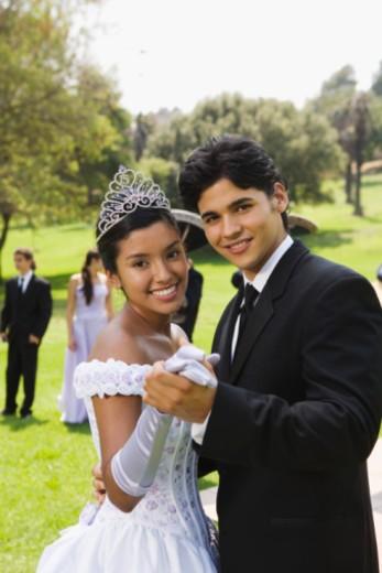 Teenage boy and teenage girl dancing at quinceanera : Stock Photo