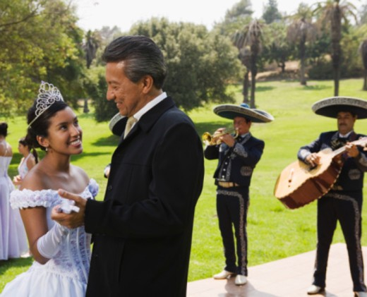 Grandfather and teenage girl dancing at quinceanera : Stock Photo