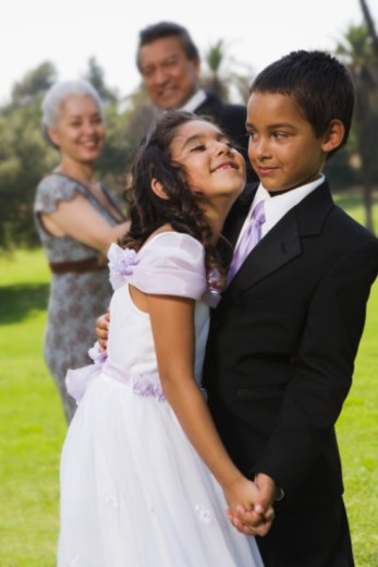 Boy and girl dancing at quinceanera : Stock Photo