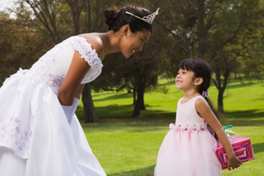 Teenage girl receiving gift at quinceanera : Stock Photo