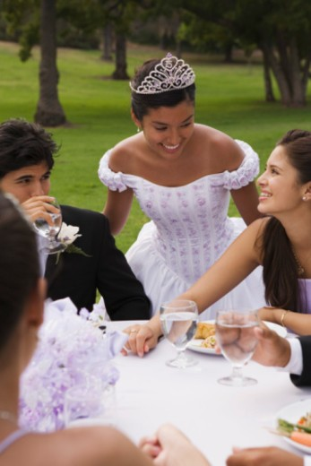 Stock Photo: 1555R-336202 Teens at table at quinceanera