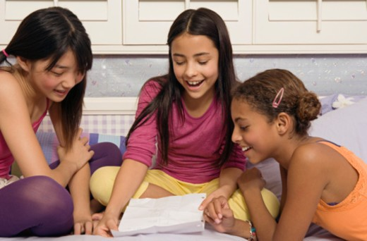 Stock Photo: 1555R-336361 Preteen girls writing a note