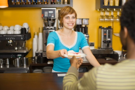Stock Photo: 1555R-336367 Smiling woman serving customer