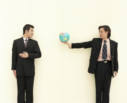 Stock Photo: 1555R-336625 Businessmen with globe