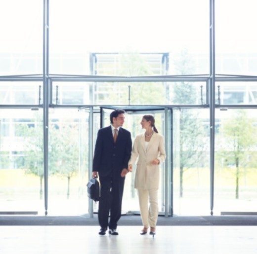 Businesspeople entering office : Stock Photo