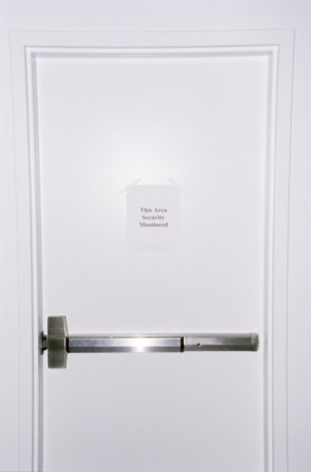 Door with security sign : Stock Photo