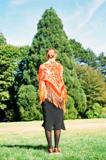Woman with a shawl by a tree : Stock Photo