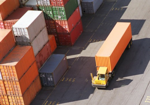 Stock Photo: 1555R-338187 Cargo truck in container shipyard