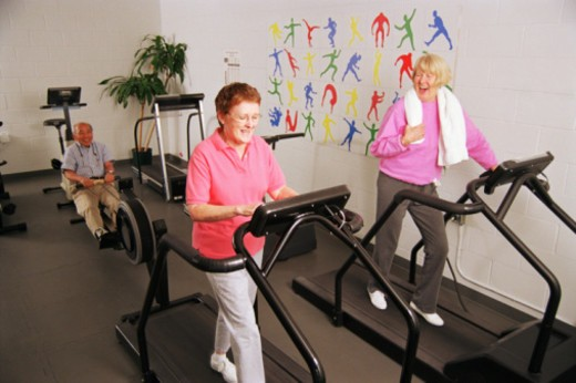 Stock Photo: 1555R-338207 Seniors working out in gym
