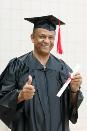 Stock Photo: 1555R-339067 Graduate with diploma