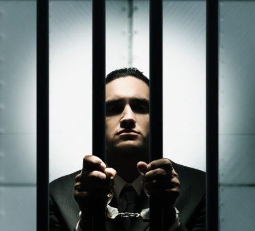 Businessman in jail : Stock Photo