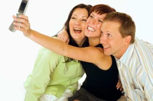 Stock Photo: 1555R-339637 Friends posing for camera phone