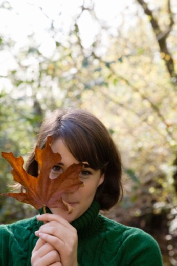 Stock Photo: 1555R-340354 Woman with a leaf