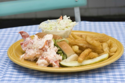 Stock Photo: 1555R-340387 Plate of french fries and lobster rolls